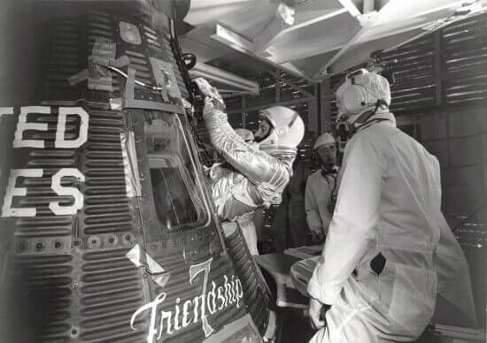 "Astronaut John H. Glenn Jr. enters his Mercury capsule, ""Friendship 7"" as he prepares for launch of the Mercury-Atlas rocket."