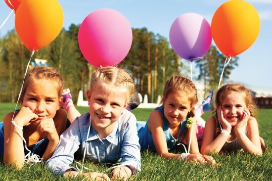 Group Of Happy Children With Balloons