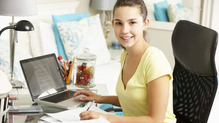 Teenage Girl Studying At Desk